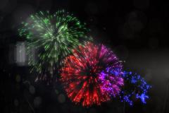 Stock Illustration of Colourful fireworks exploding on black background