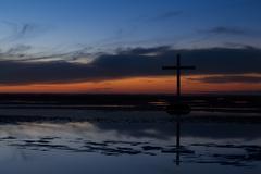 black cross tide sundown - stock photo