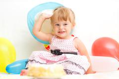 Stock Photo of Little girl celebrating second birthday