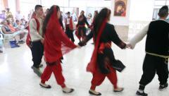 Upbeat modern Arab Christian young females and males dance Dabke - stock footage
