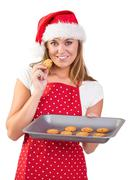 Festive homemaker showing hot cookies Stock Photos