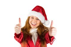 Stock Photo of Festive redhead showing thumbs up