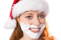 Festive redhead in foam beard - stock photo