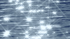 Flashing of the white eight ray stars on blue and gray water. Play of sunshine. Stock Footage