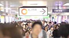 Passengers hurry at Ikebukuro station in Tokyo, Japan Stock Footage