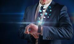 Composite image of businessman using hologram watch Stock Illustration