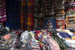 Shopping for Fabrics and Textiles in Ecuador Stock Photos