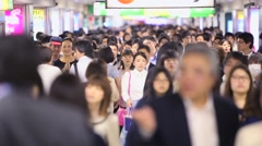 Slow Motion Passengers hurry at Ikebukuro station in Tokyo, Japan. Stock Footage