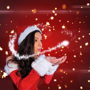 Composite image of pretty girl in santa outfit blowing - stock illustration