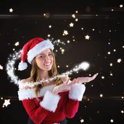 Composite image of sexy santa girl presenting with hands Stock Illustration