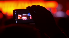 Making video with cell phone at live music concert, festival Stock Footage