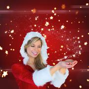 Stock Illustration of Composite image of pretty girl holding hands out in santa outfit