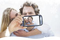 Composite image of hand holding smartphone - stock illustration