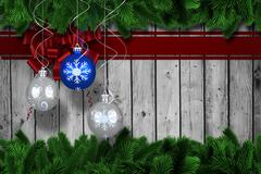 Composite image of digital hanging christmas bauble decoration - stock illustration