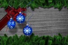 Composite image of digital hanging christmas bauble decoration - stock illustration