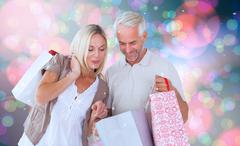 Composite image of happy couple with shopping bags Stock Illustration