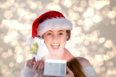 Composite image of sexy girl in santa costume opening a gift - stock illustration