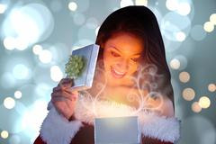Composite image of sexy santa girl opening gift Stock Illustration