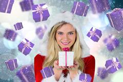 Stock Illustration of Composite image of pretty girl in santa outfit holding gift