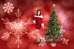 Stock Illustration of Composite image of pretty girl smiling in santa outfit