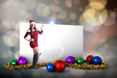 Composite image of sexy santa girl pointing Stock Illustration