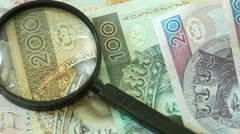 Polish zloty banknotes with magnifying glas. Full HD with motorized slider 1080p - stock footage