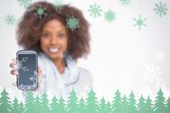 Stock Illustration of Composite image of woman with afro showing her smartphone