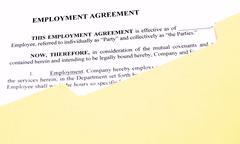 Employment Agreement in File Folder - stock photo