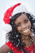 Stock Illustration of Composite image of woman wearing red dress and santa claus hat