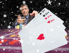 Composite image of gambler holding whiskey at poker table with digital hand of Stock Illustration
