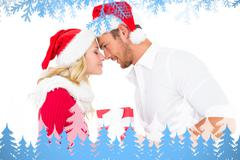 Composite image of festive young couple exchanging presents Stock Illustration