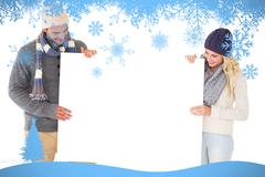 Composite image of attractive couple in winter fashion showing poster Stock Illustration