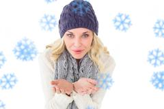 Composite image of pretty blonde in winter fashion blowing over hands Stock Illustration
