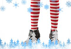 Stock Illustration of Composite image of lower half of girl wearing stripey socks and boots