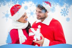 Composite image of attractive festive couple holding a gift - stock illustration
