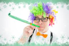 Composite image of geeky hipster wearing a rainbow wig blowing party horn Stock Illustration