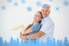 Composite image of happy couple hugging and holding paint roller Stock Illustration