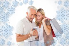 Stock Illustration of Composite image of happy couple holding shopping bags and smartphone
