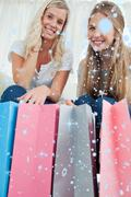 Composite image of close of bags with girls above them smiling - stock illustration
