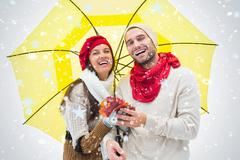 Composite image of attractive young couple in warm clothes holding umbrella and - stock illustration