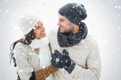 Composite image of attractive young couple in warm clothes - stock illustration