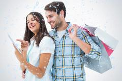Composite image of attractive young couple with shopping bags and tablet pc - stock illustration