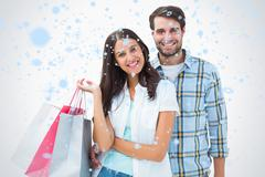 Composite image of attractive young couple with shopping bags - stock illustration