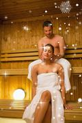 Stock Illustration of Composite image of man giving his girlfriend a neck massage in sauna
