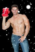 Composite image of muscular man holding pile of presents in blue jeans Stock Illustration