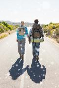 Composite image of attractive couple walking on the road holding hands Stock Illustration