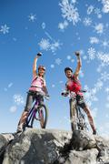 Composite image of fit cyclist couple cheering at the summit - stock illustration