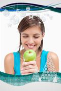 Stock Illustration of Composite image of smiling teenager looking at a green apple placed on her hands