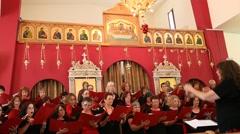 The Misgav Hagalil Liturgical Choir performs in the Church of Eilabun - stock footage