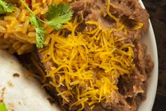 homemade refried beans with cheese - stock photo